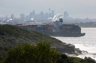 A ship enters Botany Bay with the Sydney skyline in the distance.